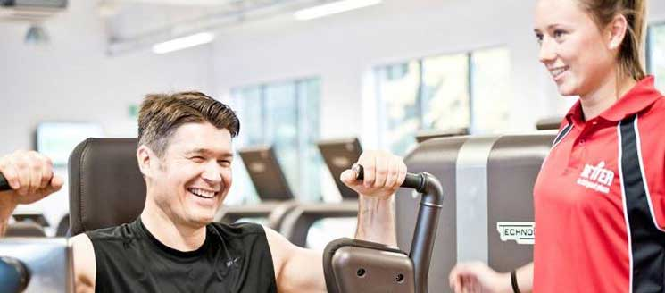 A man and a woman training in a gym