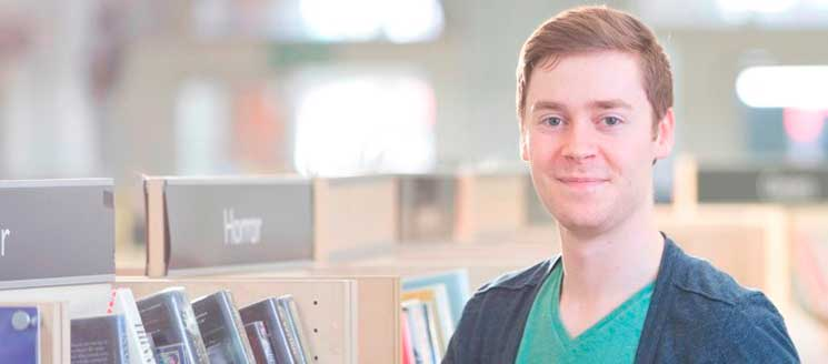 A young man in a library